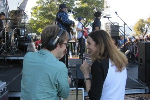 Jonathan and Ruthann anchor the live broadcast from the side of the stage at Dunphy park.